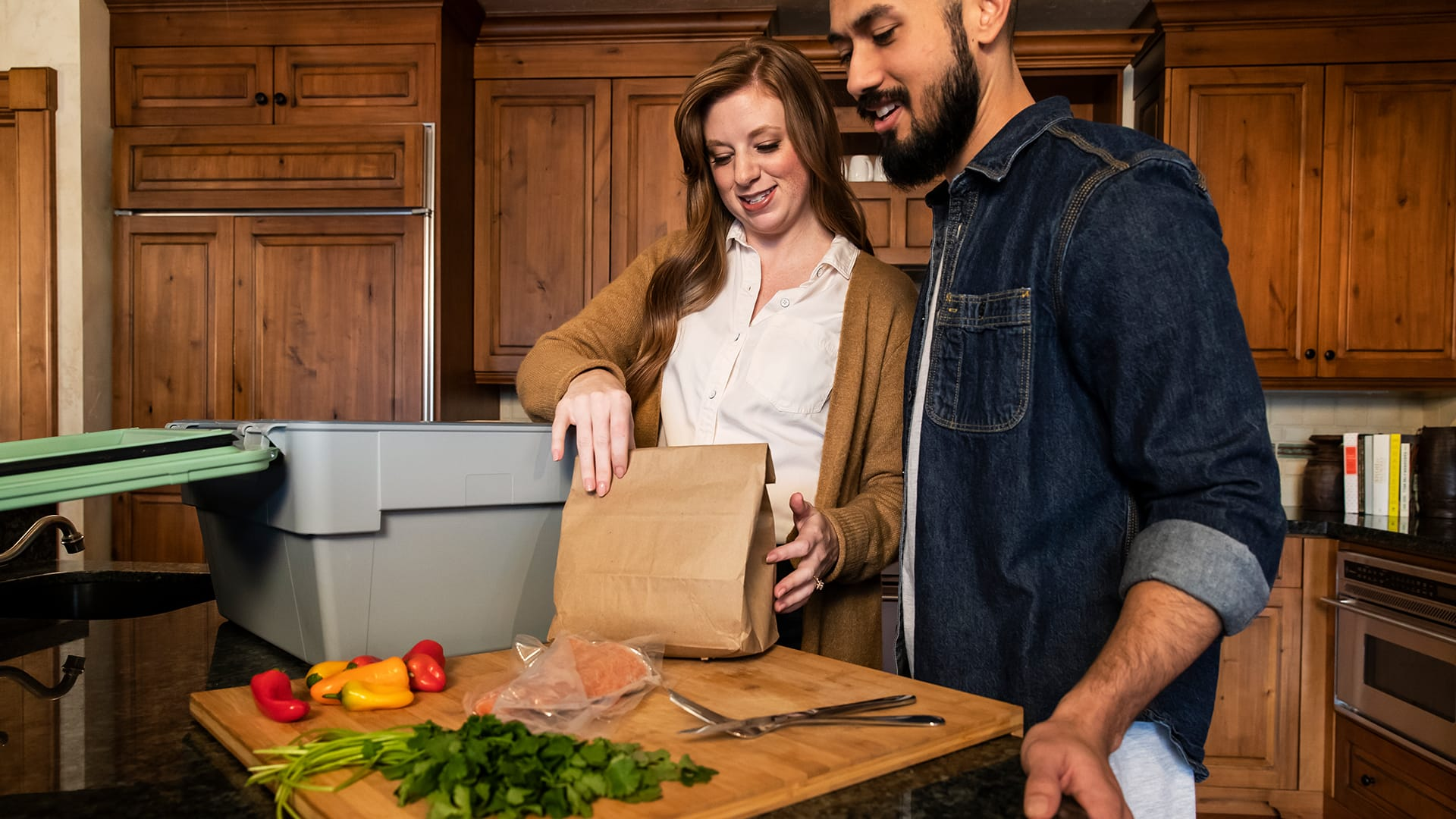 meal kit consumers taking their perishables out of reusable Liviri Fresh packaging